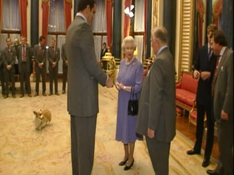 The England rugby team meet Queen Elizabeth at Buckingham Palace following their victory at the Rugby World Cup