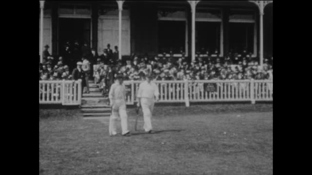 the england team walk onto the field led by their captain aw carr accompanied by apf chapman on the first morning of the 2nd ashes test match between... - テストクリケット点の映像素材/bロール