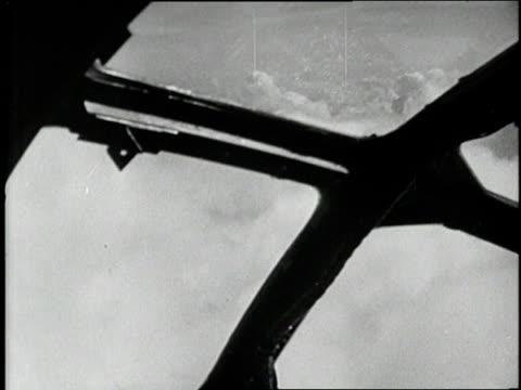 The Enola Gay B29 bomber flies through clouds
