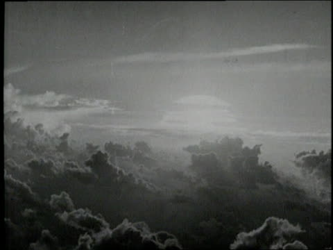 vídeos de stock, filmes e b-roll de the enola gay bomber drops a nuclear bomb on hiroshima - 1945