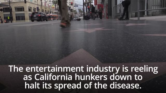 the entertainment industry is reeling as california hunkers down to halt its spread of the disease. 40 million residents have been directed to stay... - hollywood california stock videos & royalty-free footage
