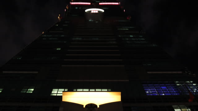 the entrance hall of the taipei financial center aka taipei 101 and a view from down of its lights - taipei 101 stock videos & royalty-free footage