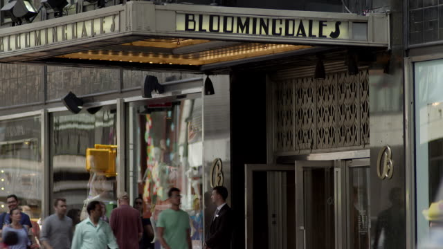 cu of the entrance to bloomingdales.  people, shoppers, and motor traffic pass by the entrance.  59th and lexington. - bloomingdales stock videos & royalty-free footage