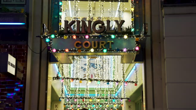 The entrance to Kingly Court, from Carnaby Street, decorated with Christmas lights