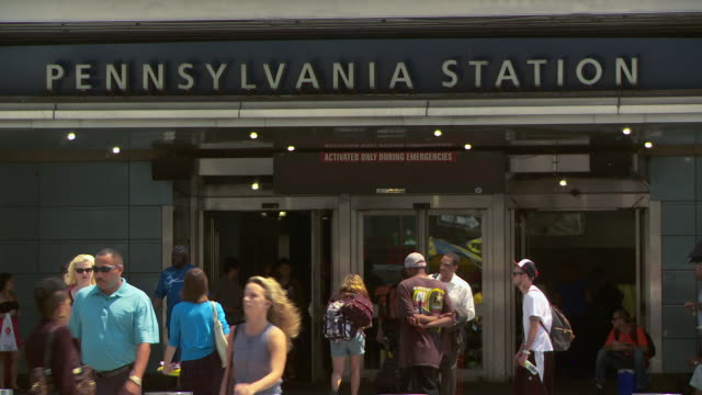 cu the entrance to pennsylvania station at 33rd and 8th ave.   - new york city penn station stock videos & royalty-free footage