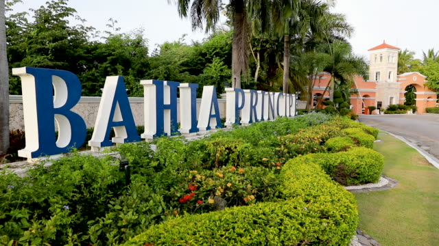 the entrance to the bahia principe resort is seen where according to family members a tourist died unexpectedly after getting sick last year on june... - punta cana stock videos and b-roll footage