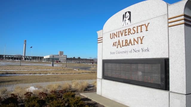 the entrance to the state university of new york at albany on washington ave in albany us various shots of a sign that reads university at albany... - albany new york state stock videos & royalty-free footage
