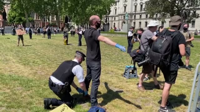 the environmentalist group called extinction rebellion held a protest in front of the british parliament by following the social distance rules due... - vitality stock videos & royalty-free footage
