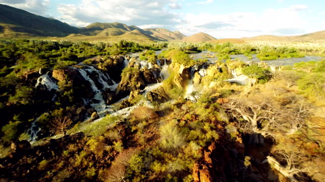 heli the epupa falls with surrounding landscape - canyon stock videos and b-roll footage