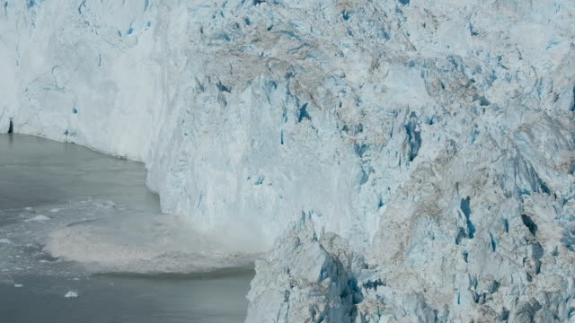the eqip sermia glacier, also called the eqi glacier, is seen behind a moraine left exposed by the glacier's retreat during unseasonably warm weather... - glacier stock videos & royalty-free footage