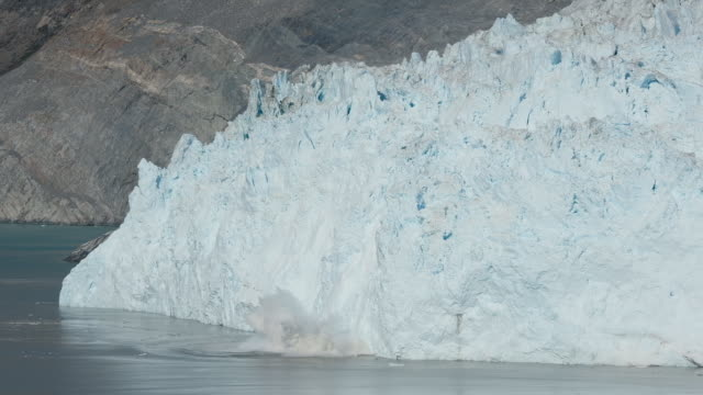 the eqip sermia glacier also called the eqi glacier is seen behind a moraine left exposed by the glacier's retreat during unseasonably warm weather... - glacier stock videos & royalty-free footage