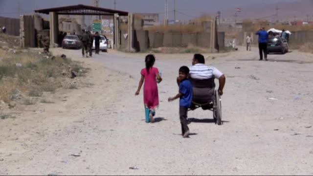the escapes of the shia turkmens continue after the clashes held in mosul's tal afar shias living in tal afar flee to sinjar due to the islamic state... - sinjar stock videos & royalty-free footage