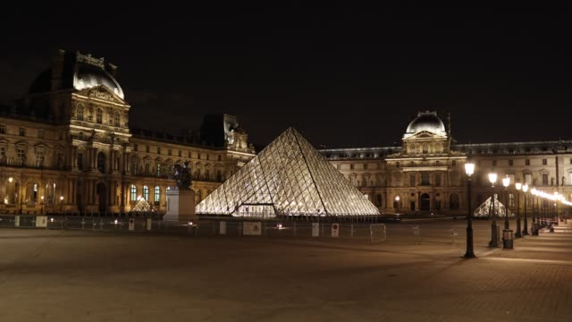 the esplanade of the louvre is deserted at curfew time on october 18, 2020 in paris, france. france. the french government has imposed a night curfew... - politics illustration stock videos & royalty-free footage