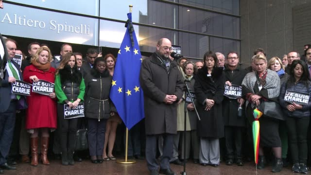 vídeos de stock, filmes e b-roll de the eu flew flags at half mast and observed a minute's silence on thursday to honour the 12 people killed in the islamist attack on the charlie hebdo... - sátira