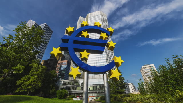 t/l of the euro symbol in front of the commerzbank tower in frankfurt - euro symbol stock videos and b-roll footage