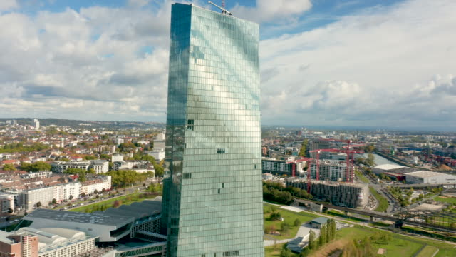 the european central bank skyscraper in frankfurt germany the european central bank the central bank of for the euro stands in the foreground next to... - orbiting stock videos & royalty-free footage