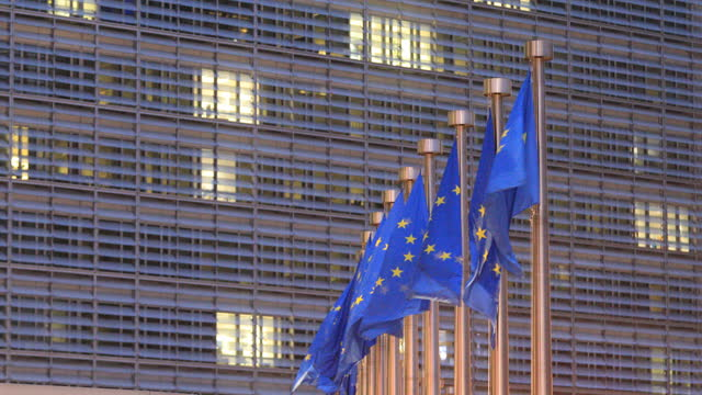 the european union flag and is seen in front of the berlaymont, the eu commission headquarter on december 09, 2020 in brussels, belgium. the british... - european union stock videos & royalty-free footage