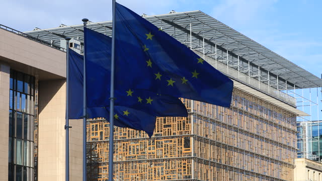 the european union flag waves in front of the europa, the eu council headquarter on may 23, 2021 in brussels, belgium. on may 24 & 25, 2021 eu... - unity stock videos & royalty-free footage