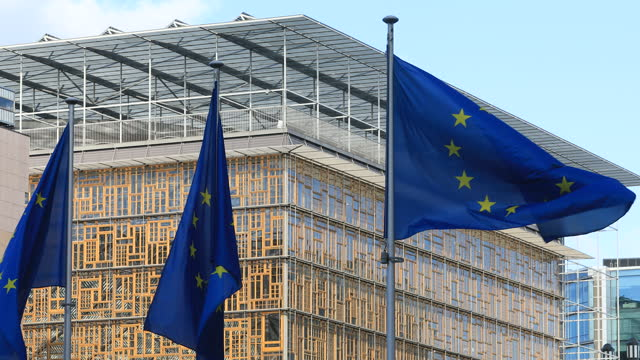 the european union flag waves in front of the europa, the eu council headquarter on may 23, 2021 in brussels, belgium. on may 24 & 25, 2021 eu... - identity stock videos & royalty-free footage