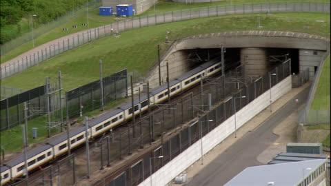 the eurostar train speeds into the chunnel in england. - eurotunnel folkestone stock-videos und b-roll-filmmaterial