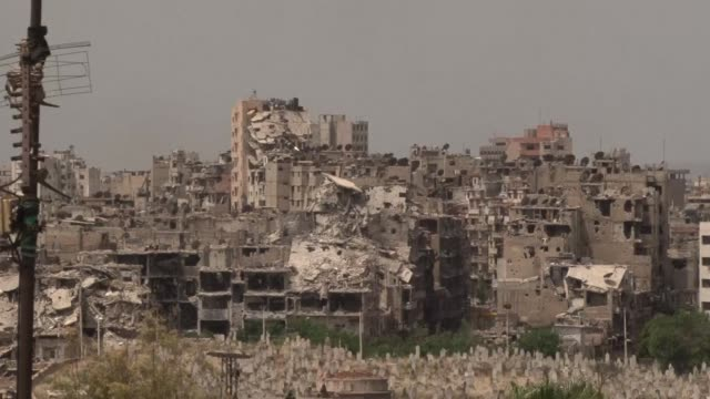 The evacuation of opposition held parts of Syrias Homs city began on Wednesday under an unprecedented deal that hands control back to the government...