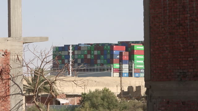 the ever given container ship that has been grounded and blocking shipping through the suez canal for almost a week, disrupting global trade, has... - suez canal stock videos & royalty-free footage