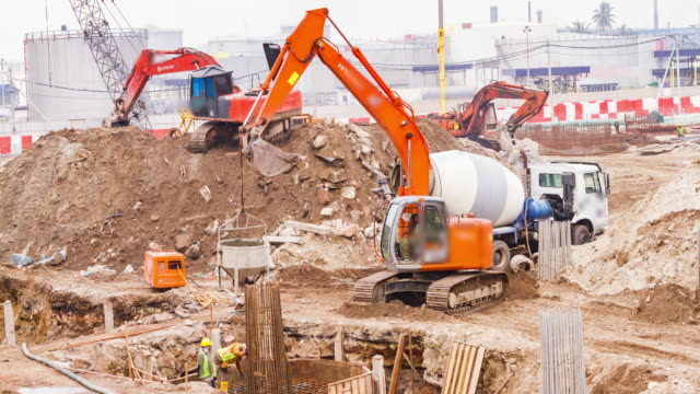 the excavator working (construction concept) - roadworks stock videos & royalty-free footage