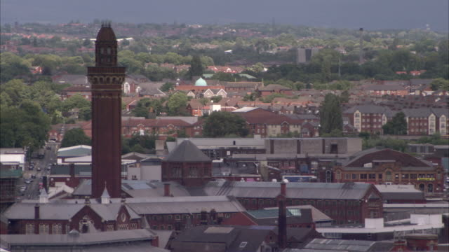 the execution tower at strangeways prison towers above rooftops in salford england. available in hd. - hm prison manchester stock videos & royalty-free footage