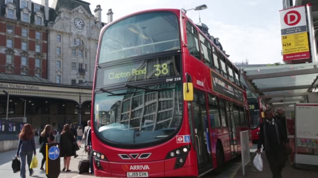 The exhaust pipe of a car as it pulls away and other traffic passes by on a road in London UK on Monday Sept 30 A red London bus drives away from a...