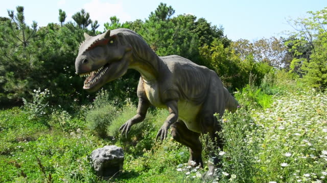 the exhibition shows sights, sounds, and smells of dinosaurs with more than 40 life-sized animatronic dinosaurs. they are set in a seven acre outdoor... - jurassic stock videos & royalty-free footage