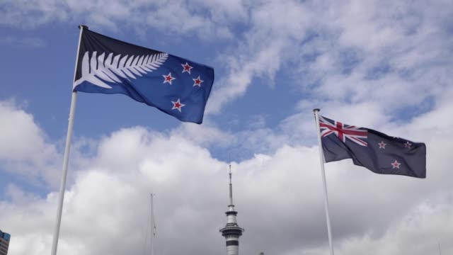 the existing new zealand flag, right, flies alongside an alternative flag design as the sky tower, center, stands in auckland, new zealand, on... - new zealand culture stock videos & royalty-free footage