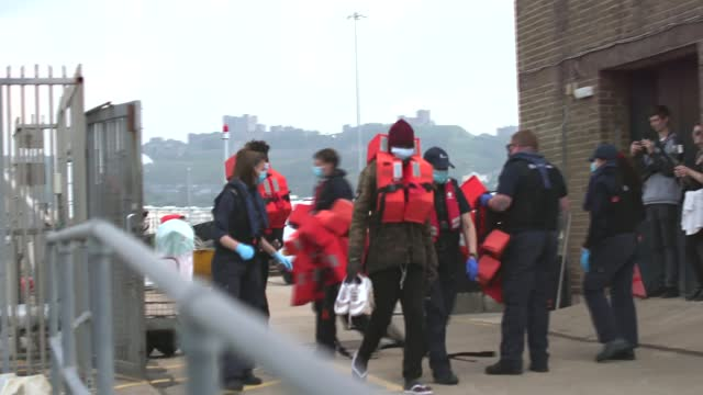 the experiences of migrants who successfully cross channel; england: kent: dover: ext tracking shot along into harbour gv border force rib along... - single object stock videos & royalty-free footage