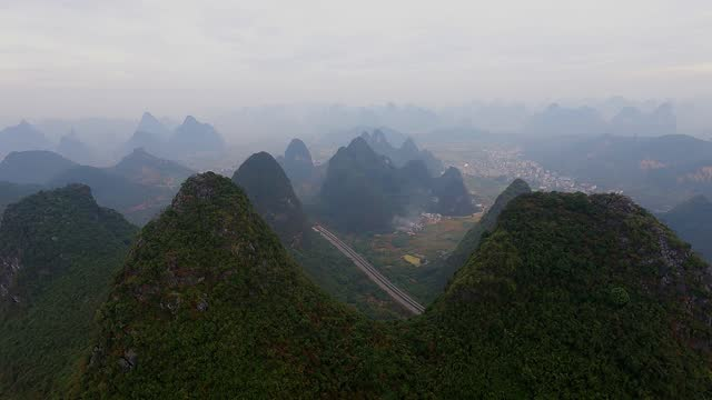 the expressway passes through karst peak forest - guilin stock videos & royalty-free footage