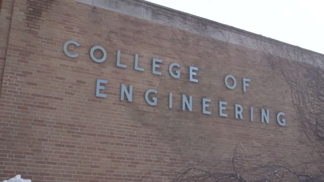the exterior and interior of buildings and various signage at michigan state university in east lansing michigan on march 23rd 2015 shots exterior... - lansing stock videos and b-roll footage