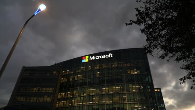 the exterior of the microsoft france head office building at dusk on october 15 in issy les moulineaux, france. with the approach of the us... - ナスダック点の映像素材/bロール