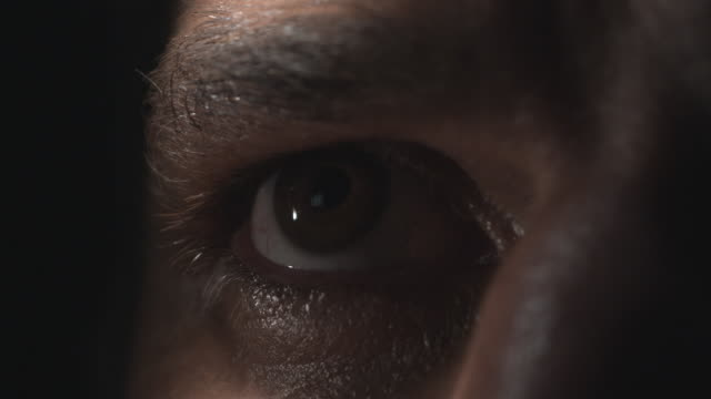 the eyebrow of a man moves up and down while he blinks. - sweat stock videos & royalty-free footage