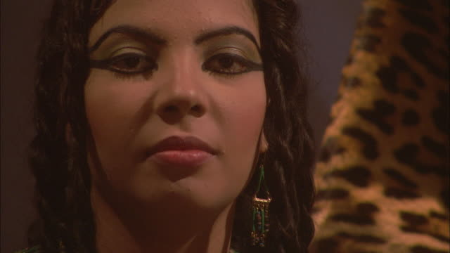 the face of a beautiful woman in ancient egypt stares straight ahead. - reenactment stock videos & royalty-free footage