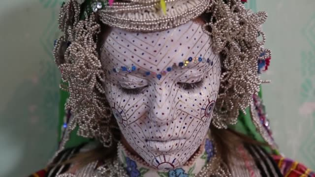 The face of a bride is painted and decorated in many layers of color by 65yearold artisan Aziza Setifagic according to their traditions in a village...