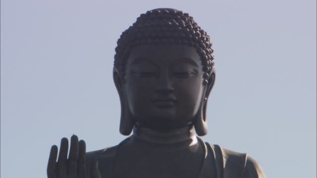 the face of a buddha statue shows serenity. - buddha stock videos & royalty-free footage