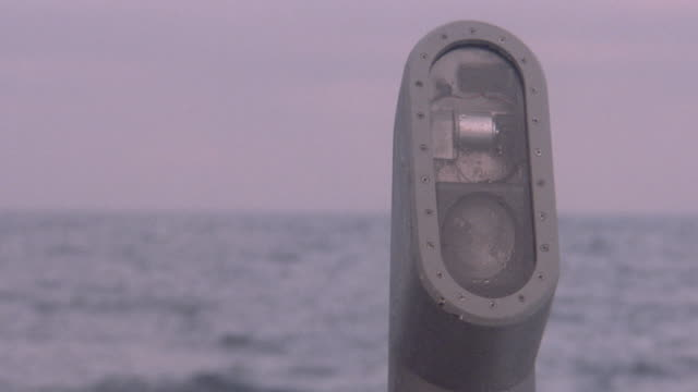 the face of a periscope reveals some of its optical equipment. - 潜水艦点の映像素材/bロール