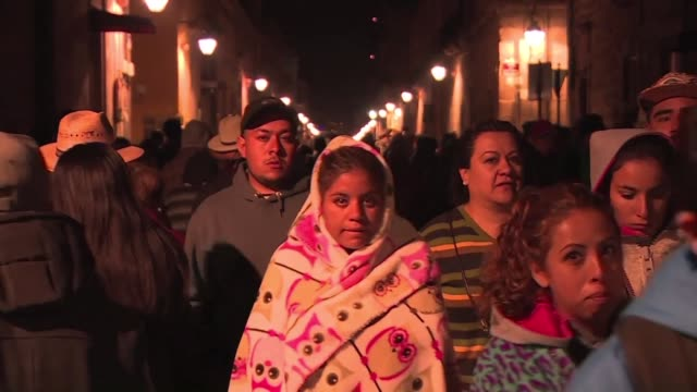 the faithful in mexicos violence ridden michoacan state camp overnight ahead of the popes visit hoping his coming will bring peace - morelia video stock e b–roll