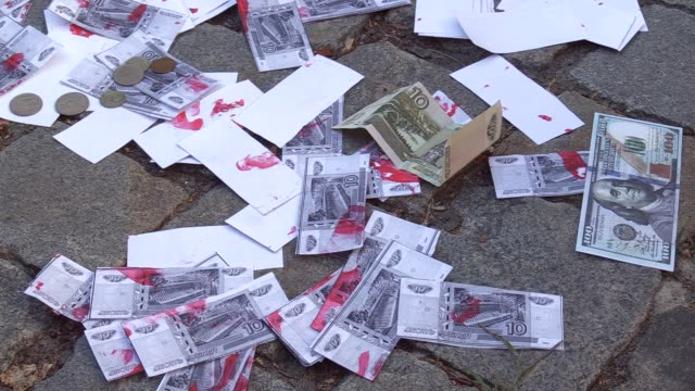 the fake money are seen during a protest against russian return to the pace in front of the austrian embassy in kiev ukraine on 25 june 2019... - austrian culture stock videos & royalty-free footage