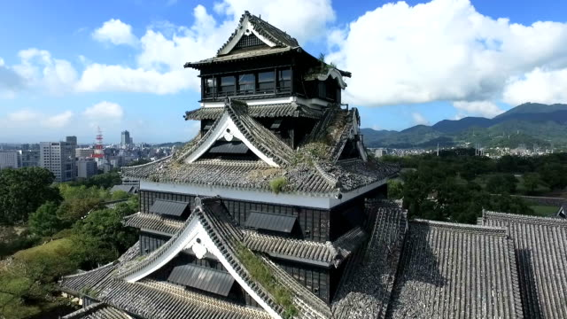 the famed kumamoto castle here now stands in a sorry state six months after a series of massive tremors rocked the region an aerial survey conducted... - 城点の映像素材/bロール
