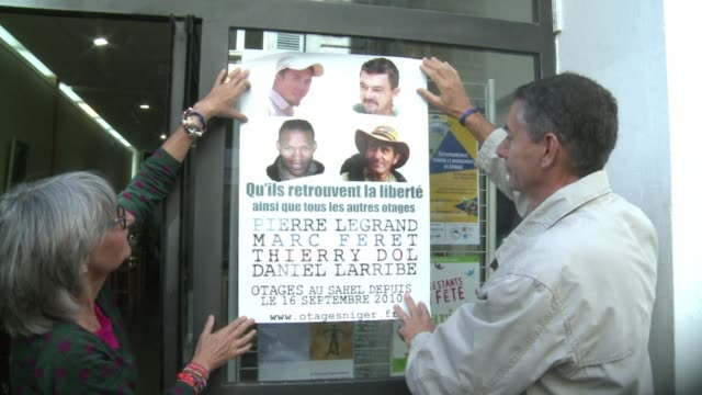 the families of three french hostages held in niger say they will go on an 18 kilometre march to remind the world of their loved ones fate three... - kilometre stock videos & royalty-free footage