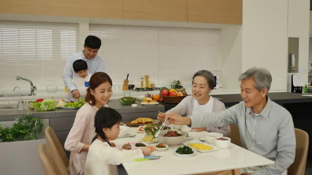 the family eat a meal sitting on the table - south korea couple stock videos & royalty-free footage