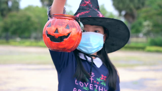 the family in the halloween costume as the coronavirus pandemic situation - halloween stock-videos und b-roll-filmmaterial