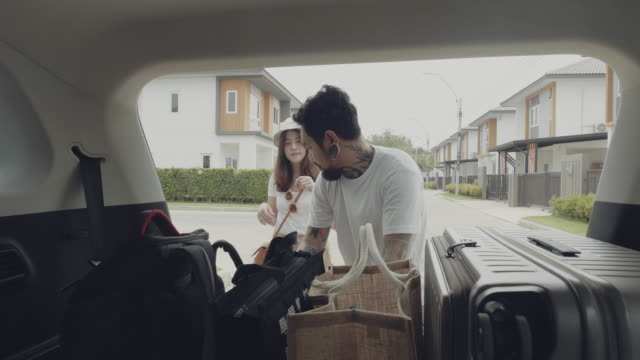 the family was preparing things for the car to leave. - luggage stock videos & royalty-free footage