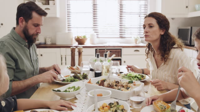 the family who eats together grows together - roast chicken stock videos & royalty-free footage