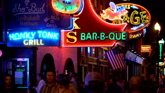 the famous beale street with neon signs of bars and pubs in memphis, tennessee - tennessee video stock e b–roll