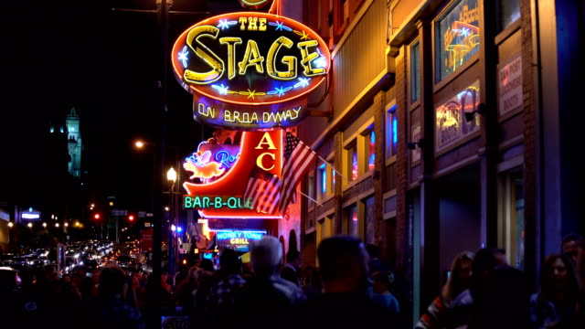 the famous beale street with neon signs of bars and pubs in memphis, tennessee - arts culture and entertainment stock videos & royalty-free footage